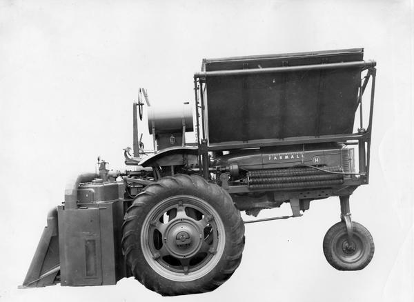 Engineering photograph of cotton picker (cotton harvester) attachment on a Farmall H high-clearance tractor.
