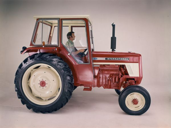 Color studio photograph of an International 574 tractor.