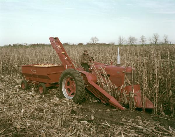 Cartoon Tractor Corn Picker : Two row mounted corn picker on farmall tractor