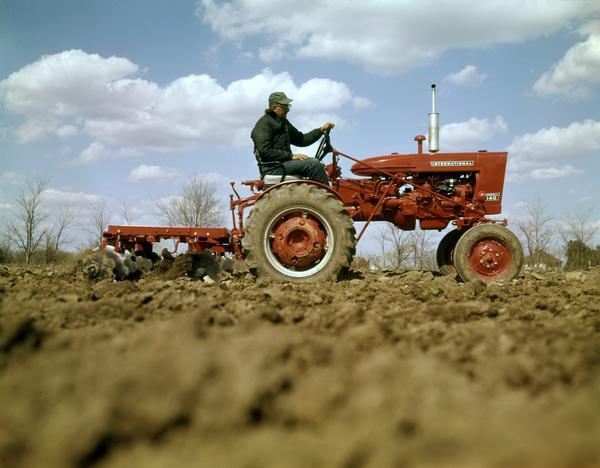 Farmall 140 Tractor : Farmall tractor and disk harrow photograph