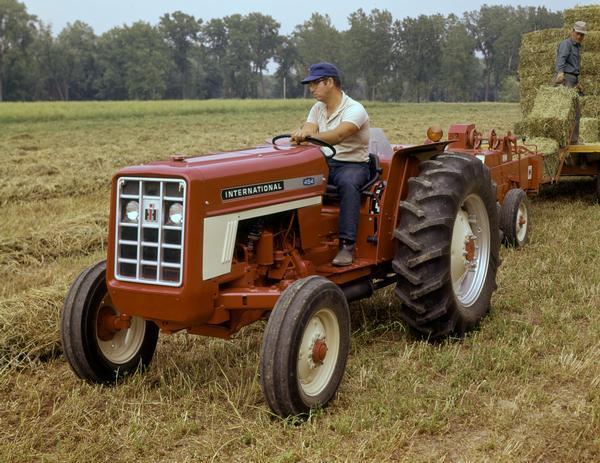 International Harvester 454 Tractor Parts : Farmers bale hay with international tractor and baler
