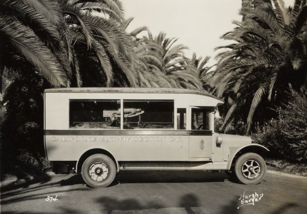 "Right side profile view of an International truck with the words: ""California Anti-Vivisection Car"" on the side. A cat and two dogs can be seen through the side windows. The animals appear to be dead, and have been posed as though they are part of experiments."