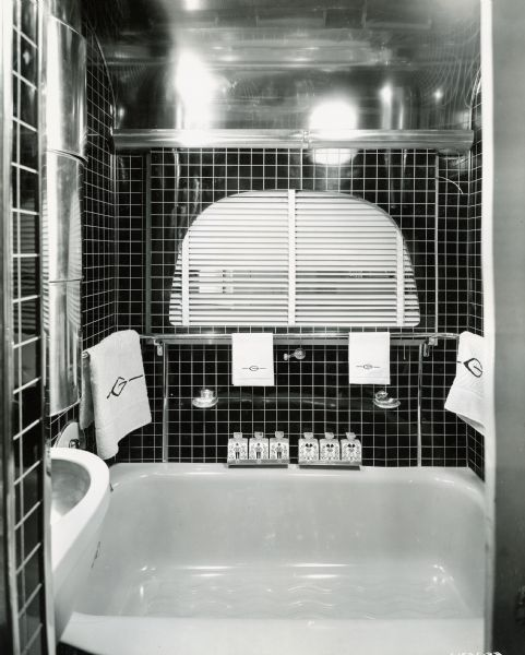 "Bathroom of an International ""Jungle Yacht"", complete with his and her toiletries and towels embroidered with the letter ""G"" for Gatti. International Harvester produced custom-built trucks called ""Jungle Yachts"" for Commander Attilio Gatti's tenth expedition to the African Congo."
