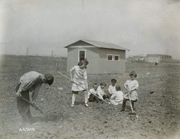 Children working and playing in a community garden at 38th and St. Louis streets.
