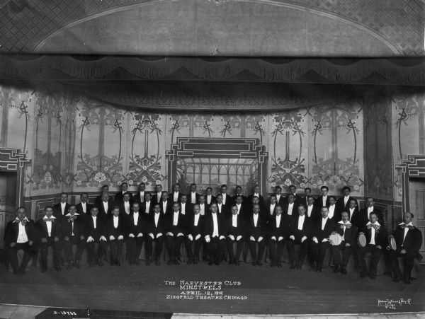 Group photograph of the Harvester Club Minstrels at the Ziegfeld Theatre.