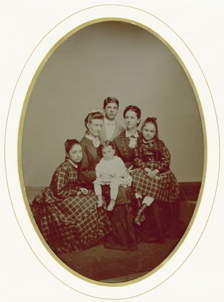 Tintype portrait of Nettie Fowler McCormick (1835-1923), with her four children: Mary Virginia McCormick (seated at left, 1861-1941), Cyrus Hall McCormick, Jr. (standing, 1859-1936), and Anita Eugenie McCormick (seated at right, 1866-1954).  An unidentified woman is holding the young Harold Fowler McCormick (1872-1941).