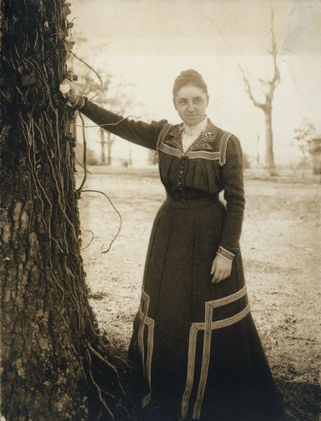 Mary Virginia McCormick (1861-1941) leaning on a tree. Mary Virginia was the daughter of Chicago industrialist and inventor, Cyrus Hall McCormick.