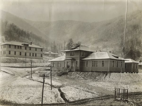 "YMCA building, with Benham Hotel and mountains in background. Benham was an International Harvester ""company town."""