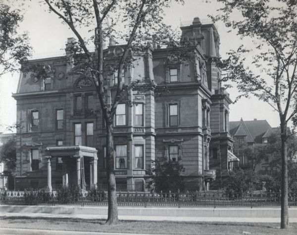 The facade of the McCormick family residence at 675 Rush Street, which takes up an entire block between Erie and Huron Streets. Cyrus Hall McCormick, Sr. hired Cudell and Blumenthal, a leading architectual firm of the time, to design the French Renaissance style home. Construction started after the Chicago fire in 1874, and was completed in 1879. Three generations of the family lived there, but it was eventually sold by the Cyrus Hall McCormick estate in 1945 and razed in the 1950's.