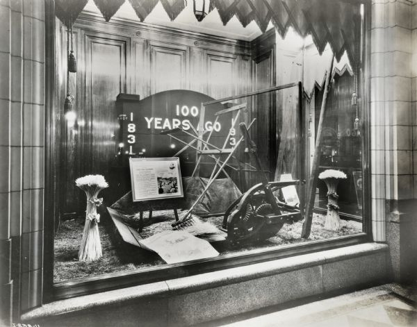 Display in the window of the Hudson Bay Company department store in Alberta, Canada, celebrating the centennial anniversary of the reaper's invention.