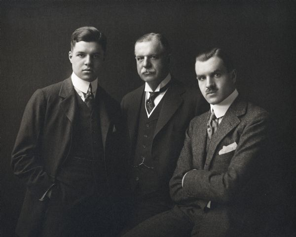 "Studio portrait of Cyrus McCormick, Jr. and his sons(?) dressed in three-piece suits and neckties. The men are (left to right): Gordon McCormick(?); Cyrus McCormick, Jr. and Cyrus McCormick III (""Cyrusie"")."