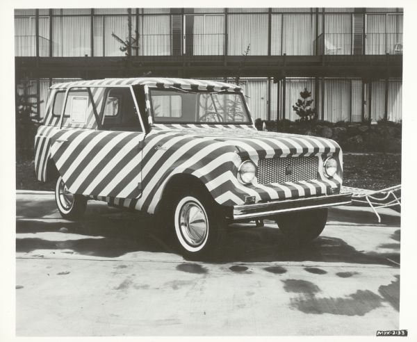 Three-quarter right side view of a IH Scout with a black and white Zebra exterior. Photograph contains presumably the negative number myk-3133 but is cut off before a date listing. Records indicate the photograph was taken between 1961-1977.