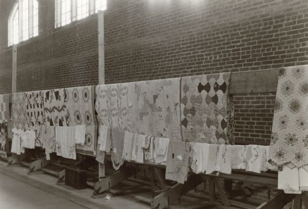 "Quilts on display at Benham. Benham, Kentucky was a ""company town"" created by International Harvester for the workers employed in the mines of its subsidiary, the Wisconsin Steel Company."