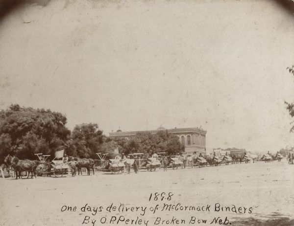 "Original caption reads: ""1898 One days delivery of McCormack [McCormick] Binders By O.P. Perley Broken Bow Neb."""