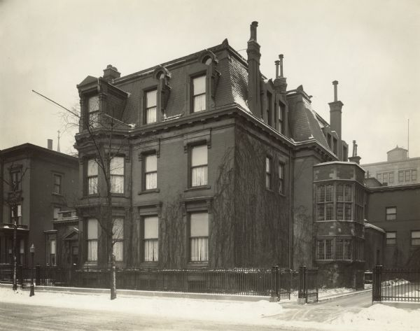 "Exterior view of Cyrus McCormick Jr's home at 50 E Huron Street.  Original caption reads: ""Frank S Fulton, Photographer. Jan 1929. 50 E Huron St, Chicago-southeast view."""