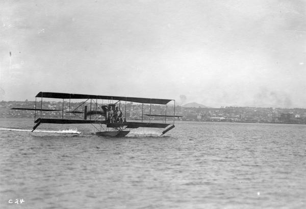 "John Kaminski (right) and a fellow student he identified only as ""Cy,"" flying one of the Glenn Curtiss flying boats on San Diego Bay."