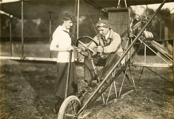 John Kaminski, his Curtiss pusher, and a young admirer.