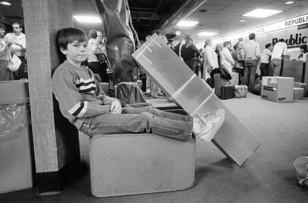 Young Ben Schreiner of Slinger waiting near the Republic Airlines ticket counter at General Mitchell International Airport for a vacation flight to Florida.