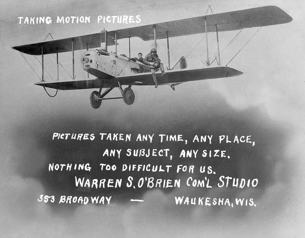 The business card of Waukesha photographer Warren O'Brien, a pioneer in aerial photography in Wisconsin. The illustration shows him sitting on the wing of a Curtiss Jenny. Walking on the wing to this position was a trick he learned from pilot Cash Chamberlain. At other times O'Brien's relatives would sit on his legs as he knelt on the seat in the cockpit. In this case, however, the picture was taken on the ground. An avid aviator himself, O'Brien served as both president and historian of the Waukesha Aviation Club.