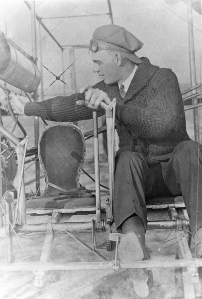 Jesse C. Brabazon of Delavan, Wisconsin in a 1911 Wright Model B, the first Wright plane designed to carry a passenger and a pilot. Previously, the passenger sat on the wing and held on tight. This plane also has dual controls which were necessary on airplanes used for instruction. It is likely, then, that this picture was taken about the time Brabazon earned his pilot's license.