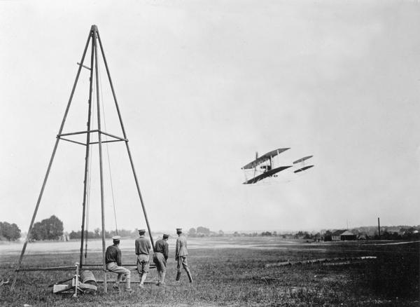 Soldiers at Fort Myer, Virginia, watching Orville Wright demonstrate the Wright Brothers' airplane for the U.S. Army. Milwaukee's Billy Mitchell is said to have attended this test as a young Signal Corps officer. This is what he would have witnessed. Mitchell was the first person with Wisconsin ties to witness the Wright Brothers' plane in flight.
