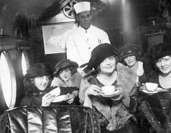 A tea party on an airplane, a publicity stunt conceived by Harry Bruno to promote his Cleveland-area airline, Aeromarine Airlines. By taking local reporters and photographers along on an aerial tea party he hoped to demonstrate that flying was safe and comfortable. Eventually Bruno left the airline business and turned to public relations where he made a specialty from his aviation background. Bruno's papers are among the many public relations collections available at the Wisconsin Historical Society Archives.
