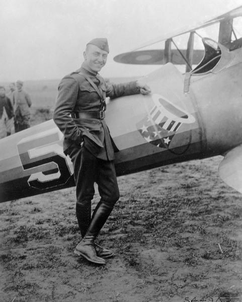 "Captain Edward V. Rickenbacker, who earned the title ""Ace of Aces"" for his 27 victories during World War I. In this photograph he is posed against a plane from his 94th ""Hat-in-the-Ring"" Squadron."