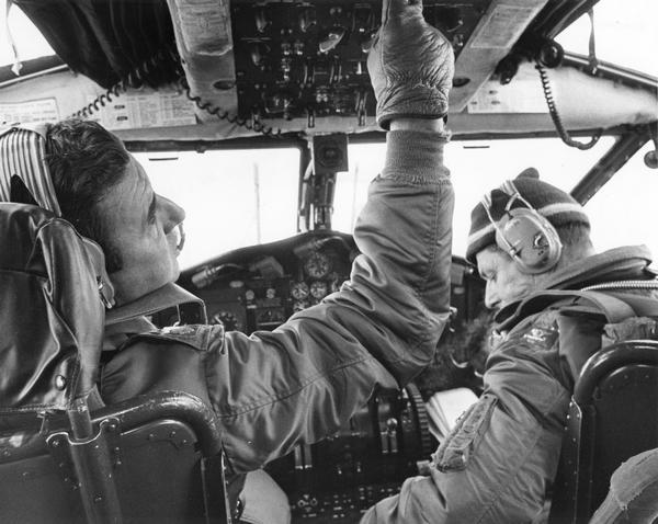 View of the cockpit as Lt. Col. Joseph Bourassa and co-pilot Leonard Dereszynski of the 440th Tactical Airlift Wing of the Air Force Reserve at General Mitchell Field prepare to shut down a C-119 for the last time. Along with the other C-119s assigned to the 440th, this plane had been flown to Davis Monthan Air Force Base in Arizona where it was to be scrapped. The pilot told the reporter covering this story that he had flown the same two-engine, unpressurized model during the Korean War.