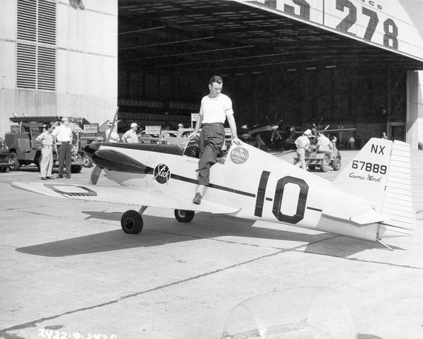 "Herman ""Fish"" Salmon and his airplane, the ""Cosmic Wind,"" at the 1947 National Air Races. This image is from the collection of Harry Bruno, the publicist for the Goodyear Trophy competition."