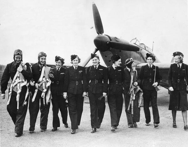 Jacqueline Cochrane (directly under the propeller) with a group of women pilots in the British Air Transport Auxiliary. One of the leading race and test pilots of her era, Jacqueline Cochrane played an important role in organizing the U.S. Women's Air Service Pilots (WASPs) after she saw the valuable work of the civilian ATA in ferrying aircraft around England.