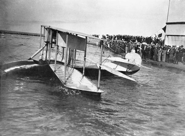 The Curtiss flying boat in which Jack Vilas made the first flight across Lake Michigan. Vilas, a Chicago businessman, was greeted by a crowd of aerial enthusiasts. His achievement was not only the first flight over the lake, but it was also the longest flight to date over water — even longer than Bleriot's crossing of the English Channel. In 1915 Vilas used the same airplane under contract with the state of Wisconsin to spot forest fires.