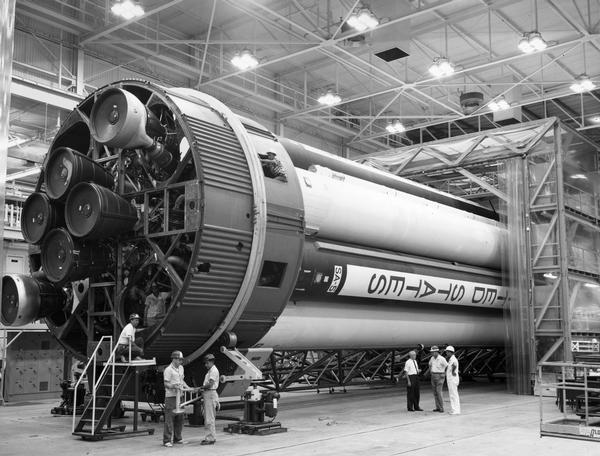 Workmen making adjustments for launch are dwarfed by the Saturn SA-5 booster rocket, a preliminary stage in the development of the Saturn V. Eventually, Saturn V would be used to launch the Apollo missions of the late 1960s and early 1970s and the Skylab Space Station.  This photograph is part of the NASA press materials collected by NBC reporter Robert Goralski. His papers are available for research at the Wisconsin Historical Society Archives.