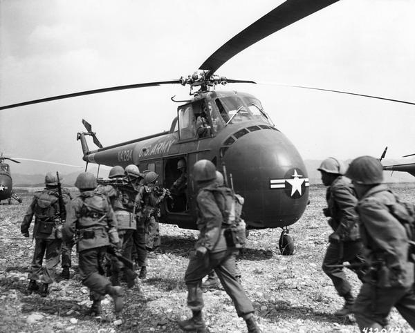 Infantry troops of the 8th Army preparing to board a Bell UH-1D helicopter of the 6th Transportation Helicopter Company for transport to the front.