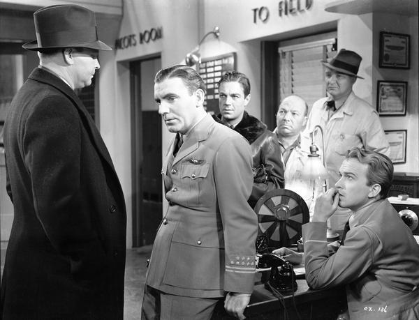 "Milwaukee-born Pat O'Brien (in the pilot's uniform) starred with Jimmy Cagney as two commercial airline pilots in ""Ceiling Zero."" This 1936 Warner Brothers release was one of many aviation films directed by Howard Hawkes."