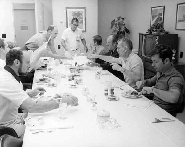 The Apollo 16 flight crew and backup crew at the breakfast served four hours before launch. With them, seated on the right side of the table and pointing, is Donald K. Slayton of Sparta, Wisconsin, the chief of the flight crew operations. Left to right around the table are: Edgar D. Mitchell, lunar module pilot Charles M Duke, Stuart Roosa, command module pilot Thomas Mattingly (partially shown), David Pallard, Charles Buckley, Slayton, and mission commander John Young.  Slayton was selected as one of the original Mercury 7 astronauts, but he was grounded because of an irregular heart beat. Slayton then became director of flight crew operations. In 1972 a healthy Slayton was restored to flight status, and in 1975 he flew on the nine-day Apollo-Soyuz mission. This photograph is part of the NASA press material collected by ABC science reporter Jules Bergman. His papers are available for research at the Wisconsin Historical Society Archives.