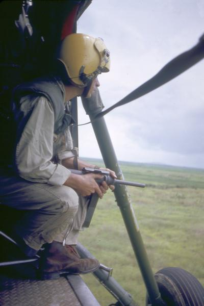 A photograph taken by Milwaukee photographer Dickey Chapelle on board a helicopter that was enroute to Vinh Quoi in the Delta Region of South Vietnam. The crew was following reports of a North Vietnamese raid in Vinh Quoi.