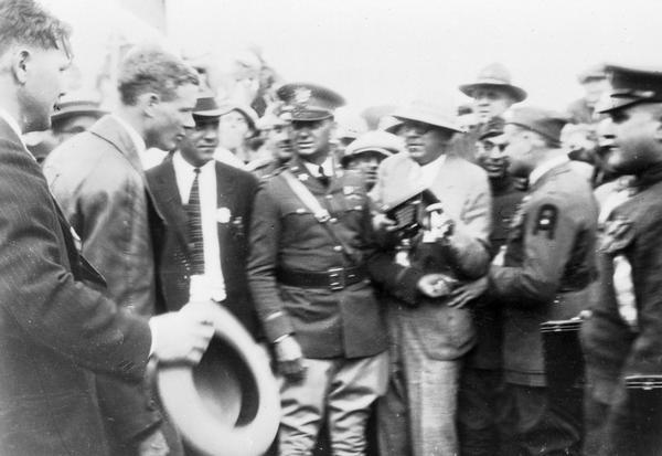 Madison admirers gather around Charles Lindbergh upon his arrival in the city. This photograph is believed to have been taken in 1928 when Lindbergh returned to receive an honorary degree from the University of Wisconsin.