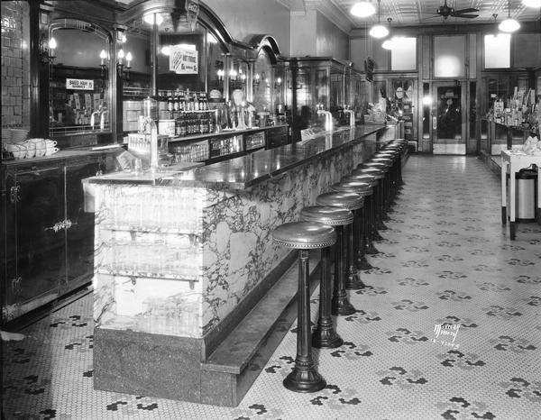 The soda fountain at Rennebohm Drug Store #3 in the Levitan Building at 13 West Main Street provides an excellent view of the store's interior decoration.