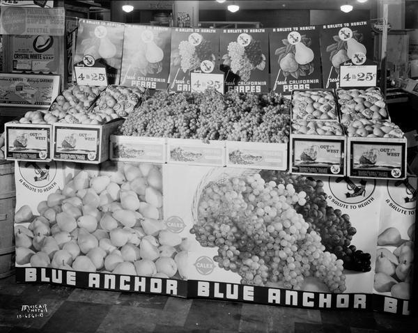 Display of Blue Anchor California pears and grapes in Badger Fruit Market, 250 State Street.
