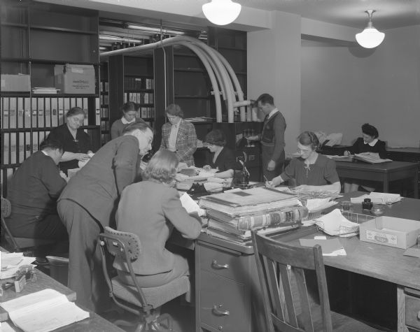 A group of employees records birth records in the Vault Room in the State Office Building (Capitol Annex), 1 West Wilson Street.