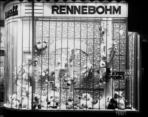 The window of Rennebohm's Drugstore #2, 204 State Street, displaying Santa Claus and an array of stuffed animal toys, mainly Teddy bears.