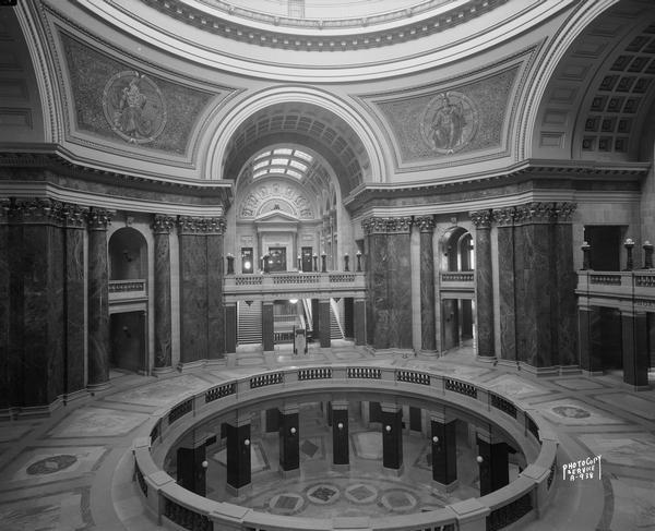 Interior of the Wisconsin State Capitol rotunda with a view of three levels of the building.