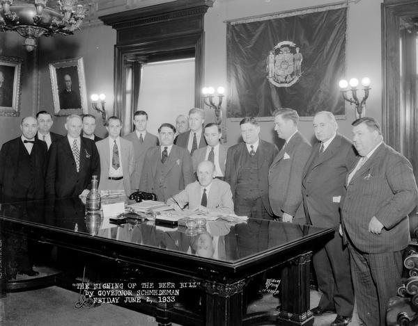 Governor Albert G. Schmedeman signing the Beer Bill with 14 men observing.