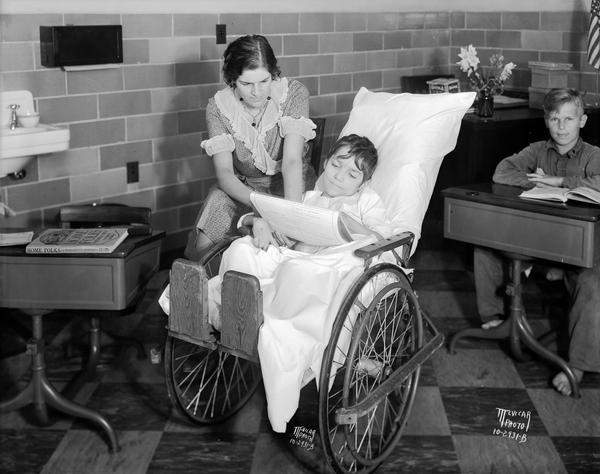 Girl in wheelchair with teacher at Wisconsin Orthopedic Hospital for Children, University of Wisconsin, 436 North Randall Street.