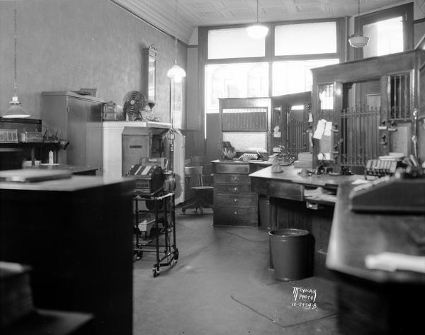 Interior view from behind teller cages of the Stoughton Bank after robbery.