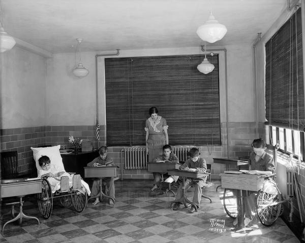 Students seated at desks at Wisconsin Orthopedic Hospital for Children, University of Wisconsin, 436 North Randall Street.