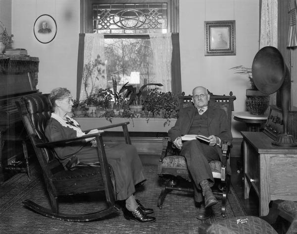 Informal portrait of Jerome C. and May Holt sitting in rockers in their living room at 1922 Madison Street.