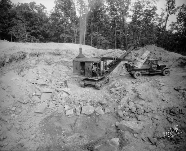 Steam shovel operators excavate for the construction of the Lake View Tuberculosis Sanitarium boiler house at 1202 Northport Drive.