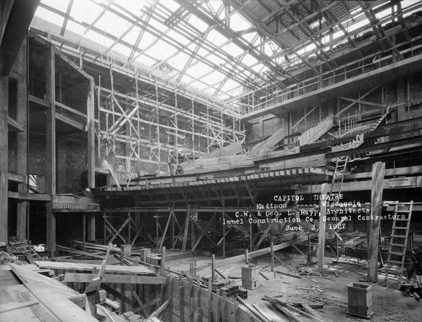 An interior view of the Capitol Theatre auditorium and balcony under construction.
