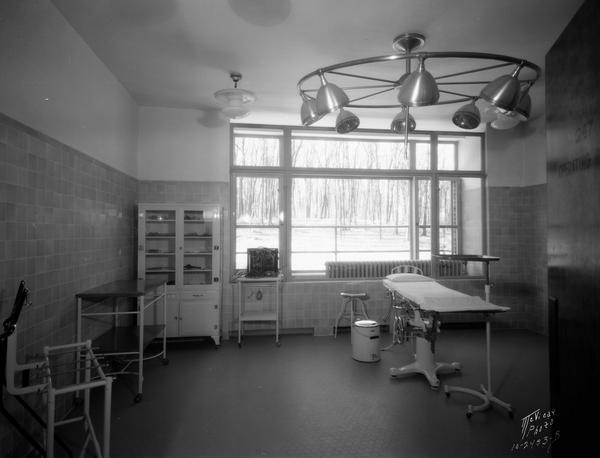 Lake View TB Sanitarium operating room. There is a large window along the back wall.